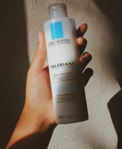 Toleriane Cleanser held against a wall